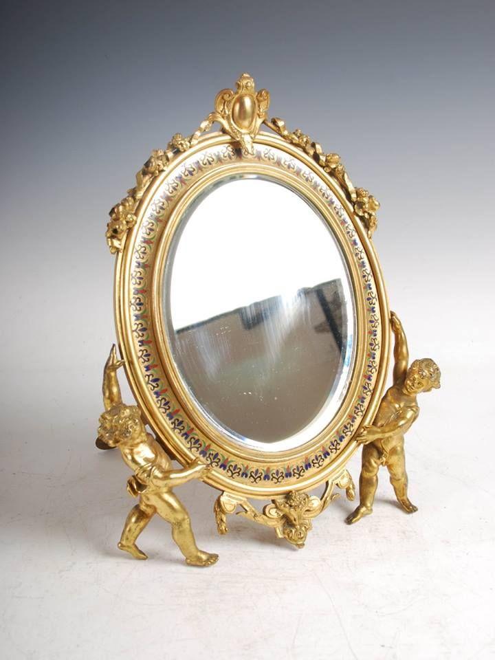 Espelho em bronze gilded a ouro do sec.19th, 32cm de altura, 2,830 USD / 2,490 EUROS / 10,140 REAIS / 18,250 CHINESE YUAN soulcariocantiques.tictail.com