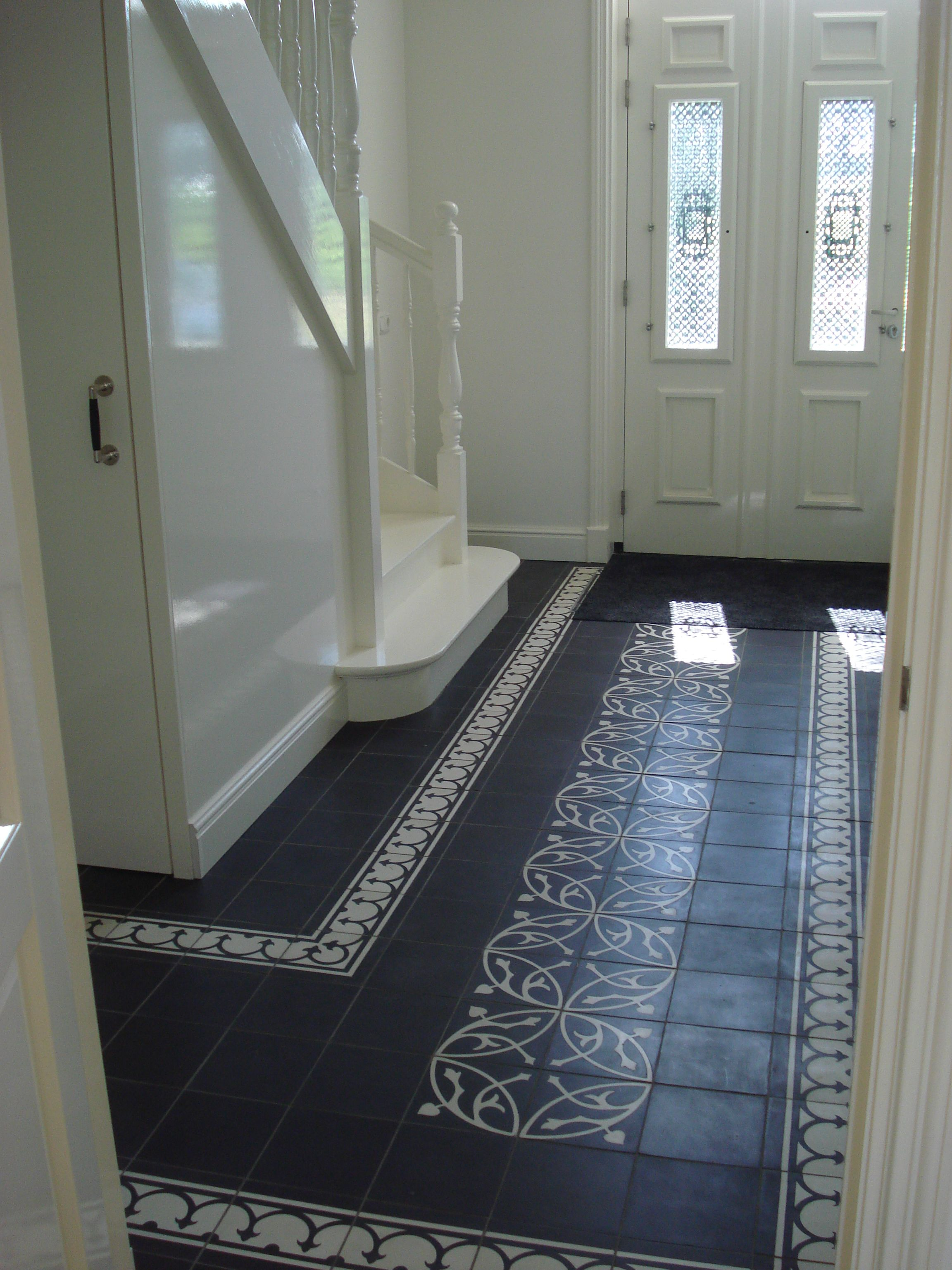 Great classic looks. Cement tiles in a hallway. White paint gives it just that little extra!