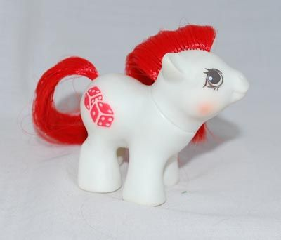 Baby Fun 'n Games ...  An Activity Club Pony released in year 9.  White body, red hair and as a Pony symbol two dice.  A Baby Earth Pony.