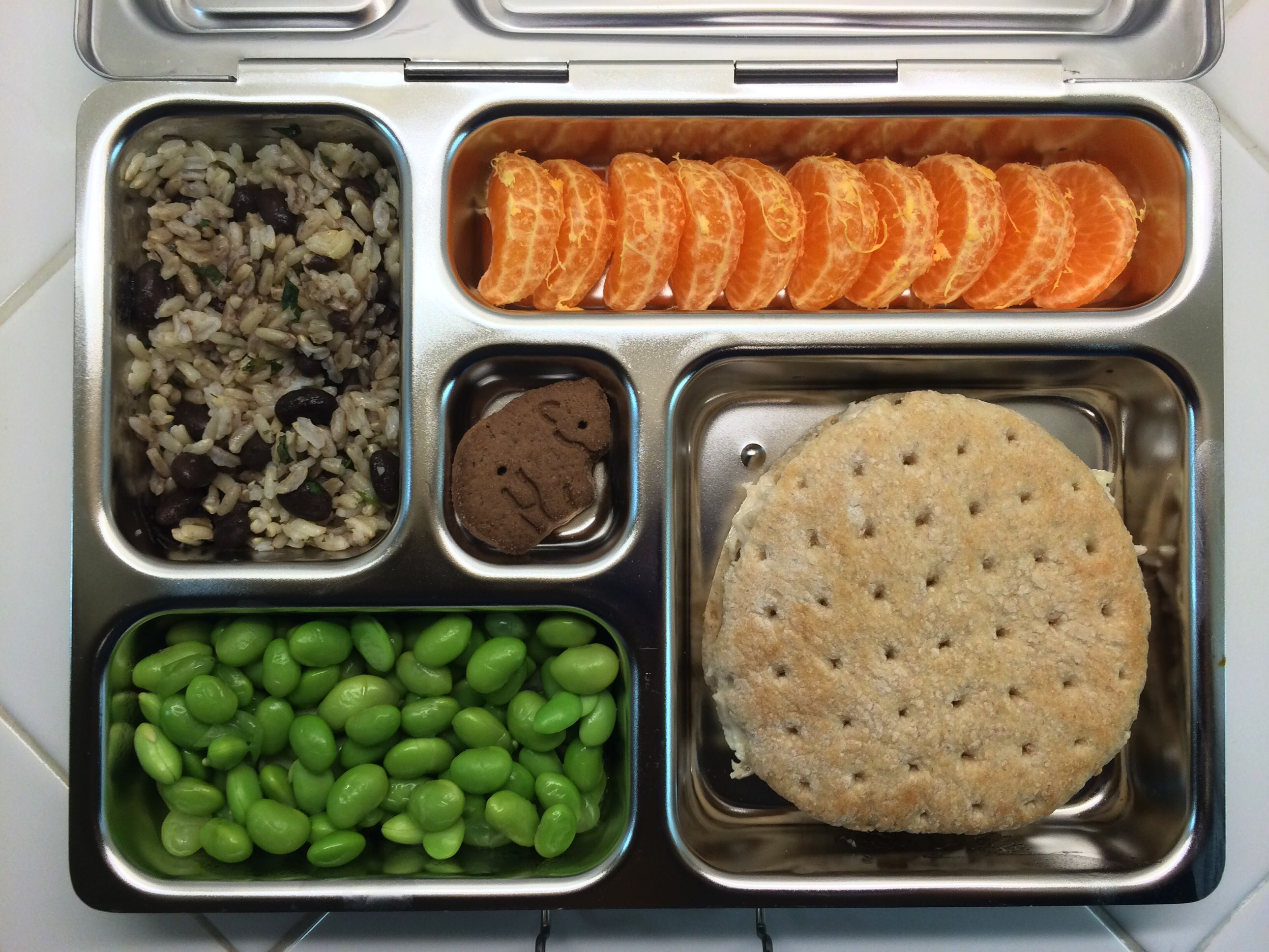 Lunch In A Box Beans And Rice Edamame Animal Cookie Clementines Chicken Salad