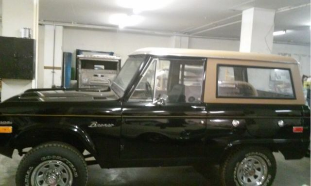 Beautifully Restored 1970 Black Bronco With A Tan Top And Black