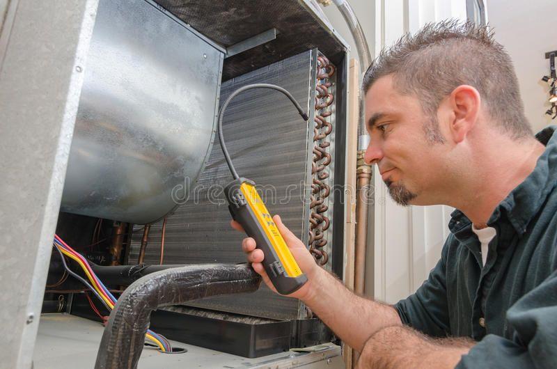 Hvac Technician With Leak Detector An Hvac Technician Searching