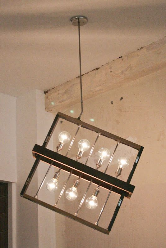 Custom light fixture made from salvaged piano wood and keys. Designed by Typewriter Boneyard for Coffee and Tea collective.