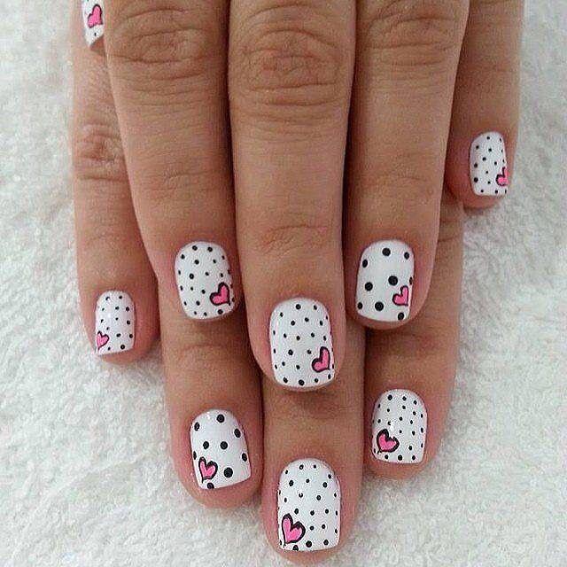 Check out this cute Polka Dots and Hearts nail design. Know anyone ...