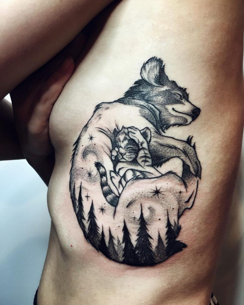 Momma Wolf And Baby Wolf Tattoo Inked On The Left Rib Cage By Sasha Tattooing Animal Tattoos Dog Tattoos Elephant Tattoos