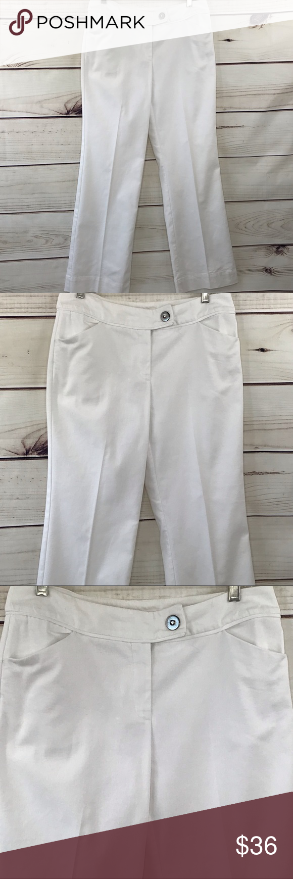 """NINE & CO. Wide Leg White Slacks With Bling Size 8 NINE & CO. Wide Leg White Slacks With Bling Size 8. Flat Front With 2 Pockets. @ Pockets on the Back. 76% Cotton 22% Poly 2% Spandex. Crisp White With the Right Amount of Stretch Make These Slacks Very Comfortable.   Measures Approximately  Waist- 15 1/2"""" Flat Rise- 9 1/2"""" Length- 30 1/2"""" Hem Width- 9""""  BM011 Nine & Co. Pants Wide Leg #whiteslacks NINE & CO. Wide Leg White Slacks With Bling Size 8 NINE & CO. Wide Leg White Slacks With Bl #whiteslacks"""