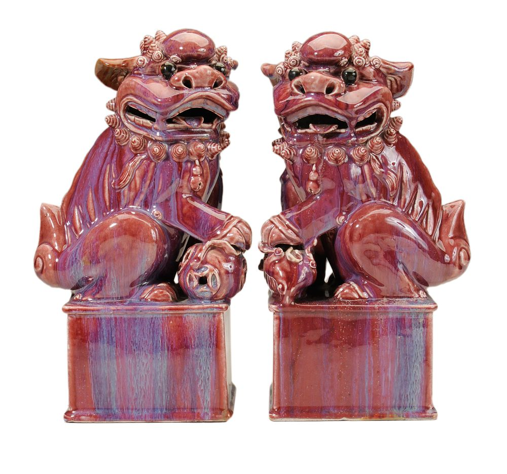 Lot 842 from our November 10-11, 2012 Auction - Pair Purple-Glazed Seated Foo Dogs - Chinese, probably 20th century, one seated figure with left paw on pup, the other with right paw on ball, both on raised rectangular platform supports with molded edges, glaze with blue runny striations front and back, 14-1/2 x 8 x 5-1/4 in. - Estimate $500 to $1,000