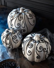 White pumpkins dressed and bejeweled.
