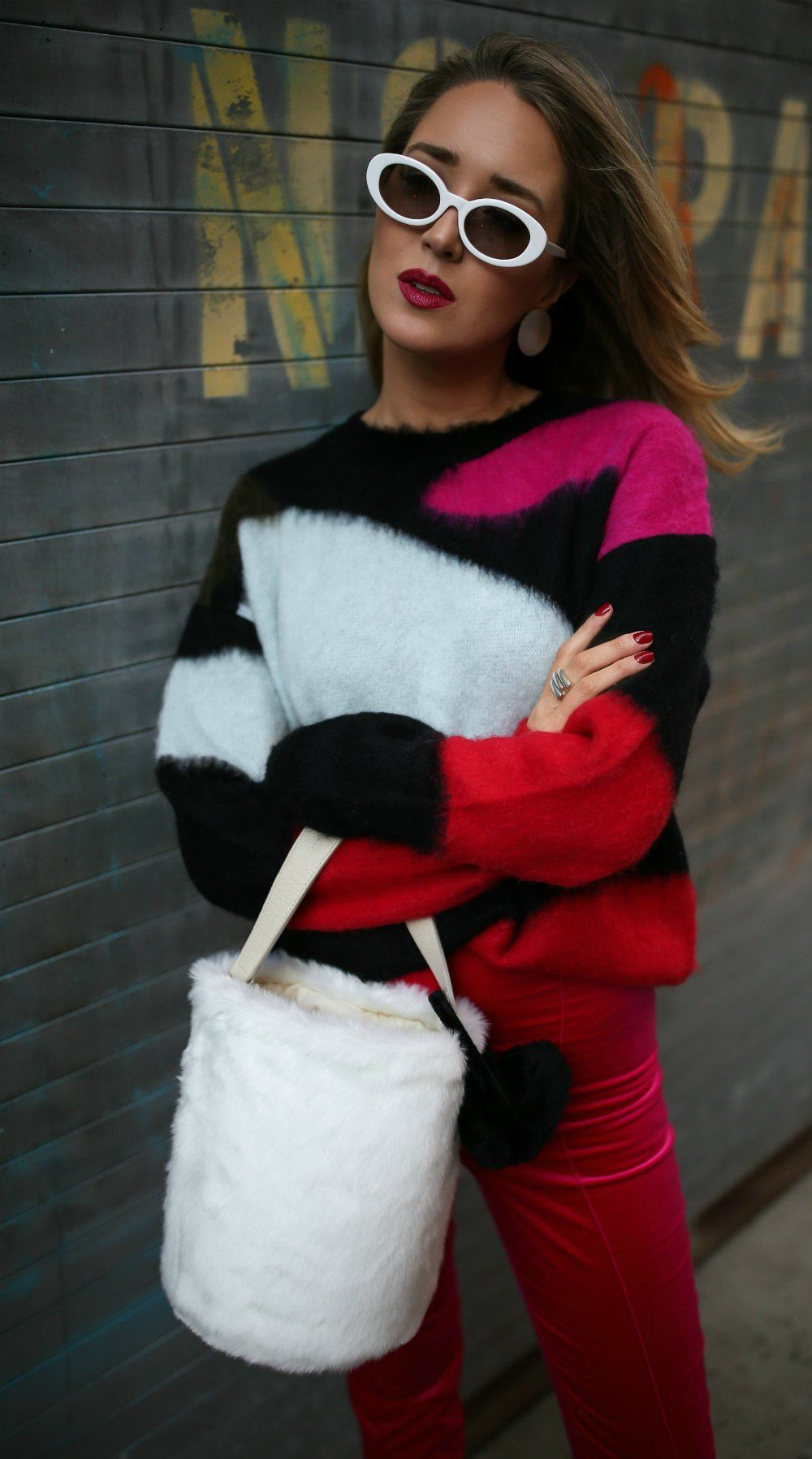d047655515a27 Ski Trip Must-Haves // Black red white color block sweater, hot pink velvet  skinny pants, white heeled pointy toe booties, white oval sunglasses, ...