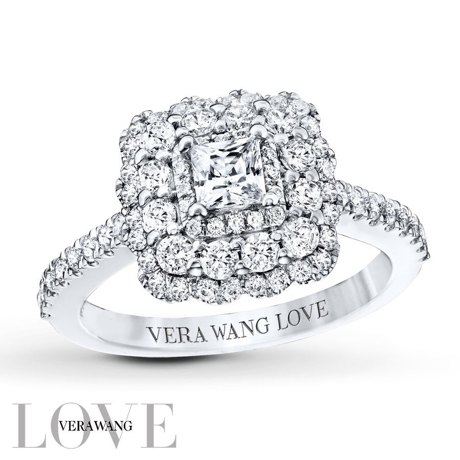 From the Vera Wang LOVE Collection, this diamond engagement ring offers incomparable beauty and unmatched quality. Timeless and elegant in 14K white gold, this exquisite design features a mesmerizing 1/3 carat princess-cut diamond center stone bordered with a frame of smaller accent diamonds. A scalloped, diamond-lined double frame encircles the center arrangement, while additional diamonds line the slender shank. Set into the bezel beneath the crown are two princess-cut blue sapphires, ...