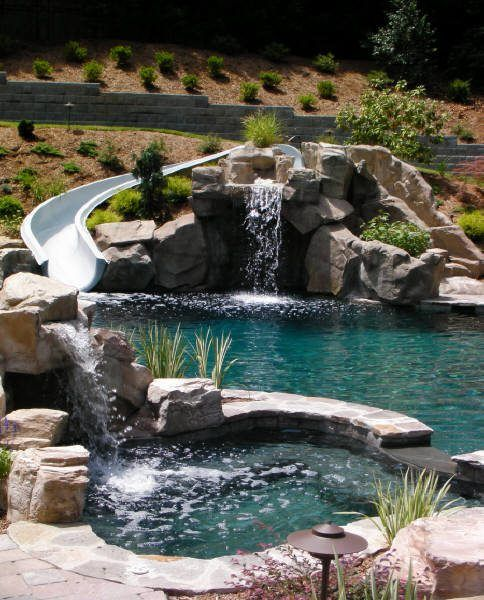 Exact pool design with hot tub slide gratto waterfalls for Natural rock swimming pools