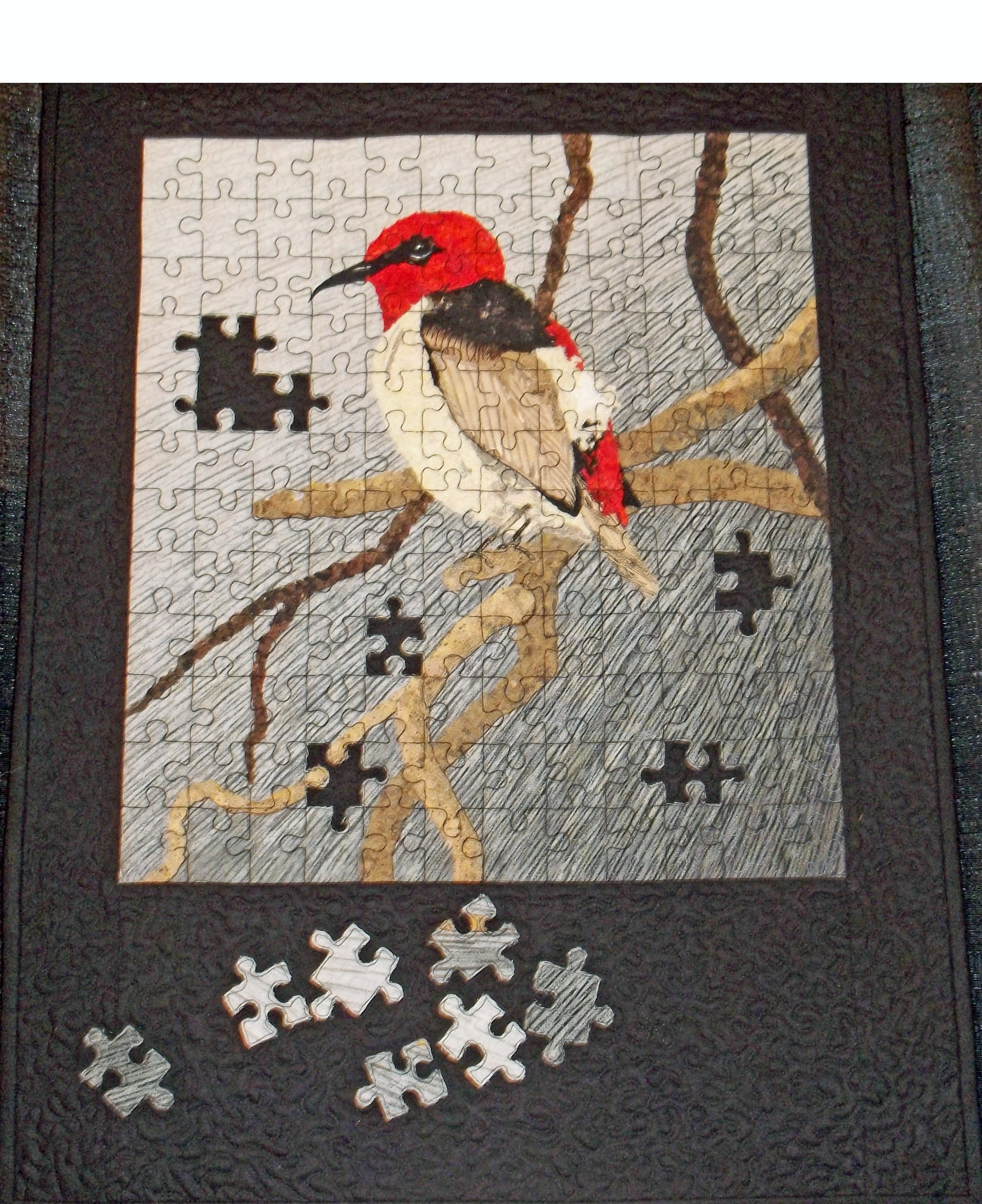 Jigsaw Puzzle Quilt With A Bird On It Puzzle