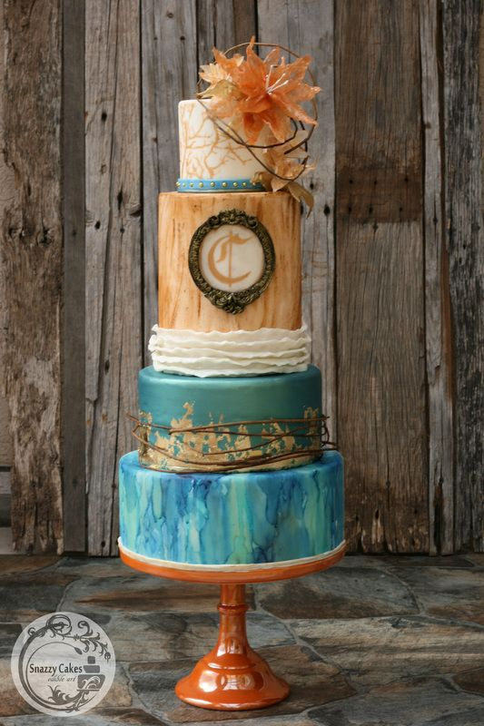 rustic modern wedding cake with gold leaf, blue water color, fondant ruffles, painted wood grain with isomalt sugar fantacy flower