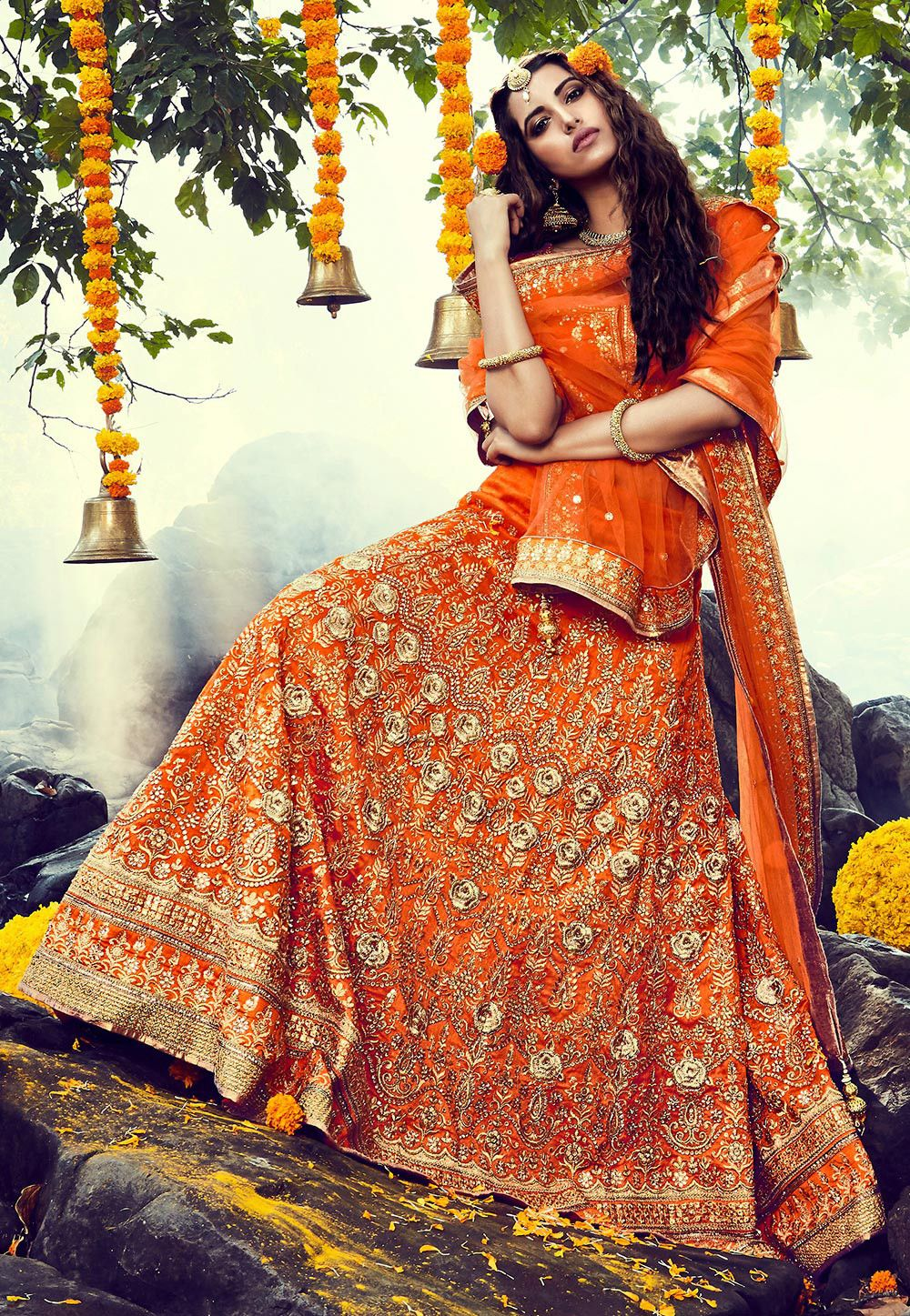 This circular lehenga in bhagalpuri silk is an orange masterpiece