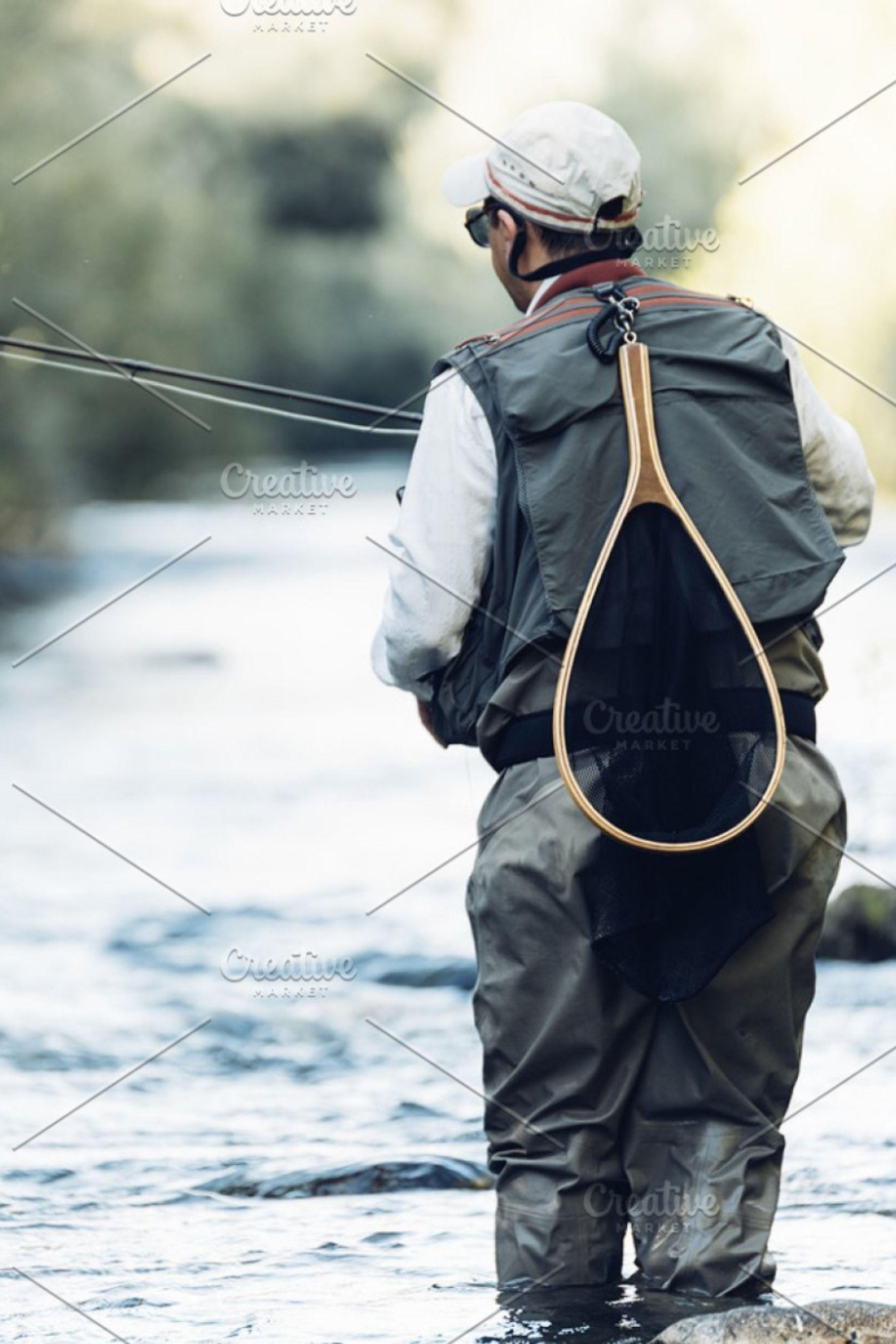 Fisherman Using Flyfishing Rod Containing Fishing Fisherman And River Fly Fishing Photo Fisherman