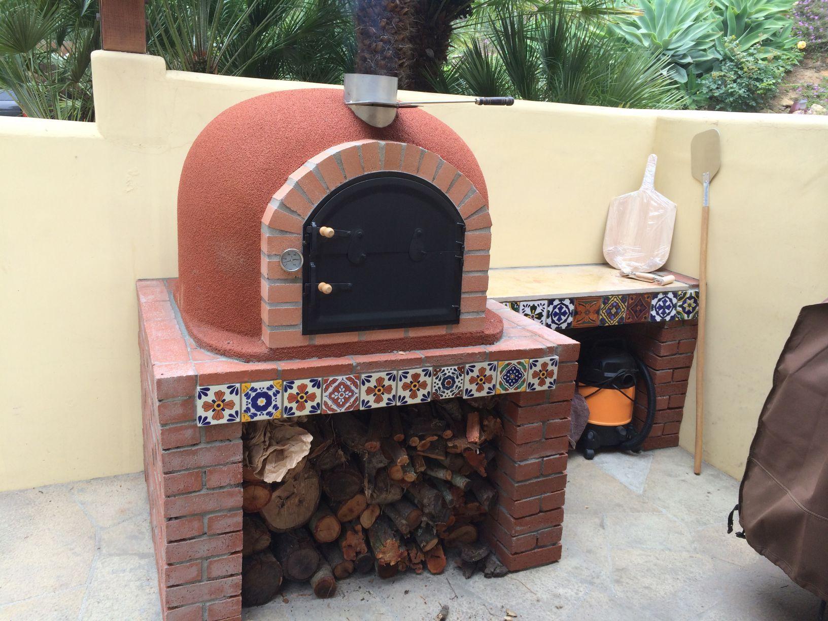 Backyard wood fired oven from portugal terracotta inside brick
