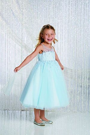 Your little one will look like she just stepped out of a fairy tale in this magical tulle dress. The dramatic crystal bead and sequin bodice with sheer beaded yoke make this style stand out as exquisite amongst thousands of others. The designer had your little princess in mind when designing this style with all of its fabulous accents. The full gathered skirt with Watteau train is meant to fall at tea length.