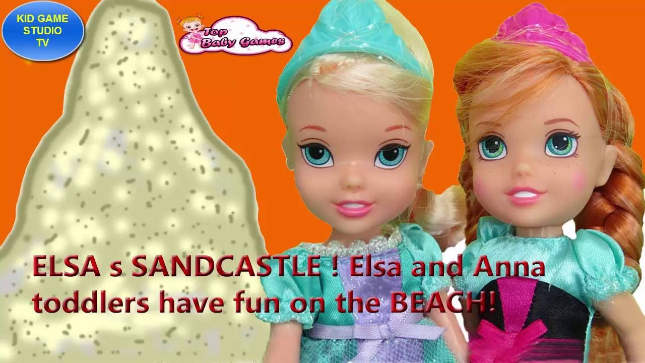 ELSA s SANDCASTLE ! Elsa and Anna toddlers have fun on the BEACH! KID GA...