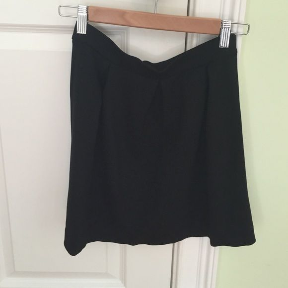 Madewell black skirt Super comfy hits mid thigh. Size 2 but runs big could fit a 4 Madewell Skirts