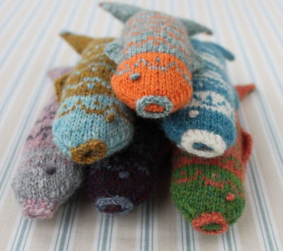 looks like a fun little project to practice fair isle, and then use any that don't work great as cat toys :)