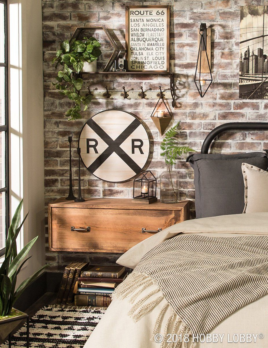 This Industrial Space Takes A Turn For The Eclectic With A Mixture Of Masculine Decor Pops Of Pattern Vintage Industrial Decor Masculine Decor Bedroom Vintage
