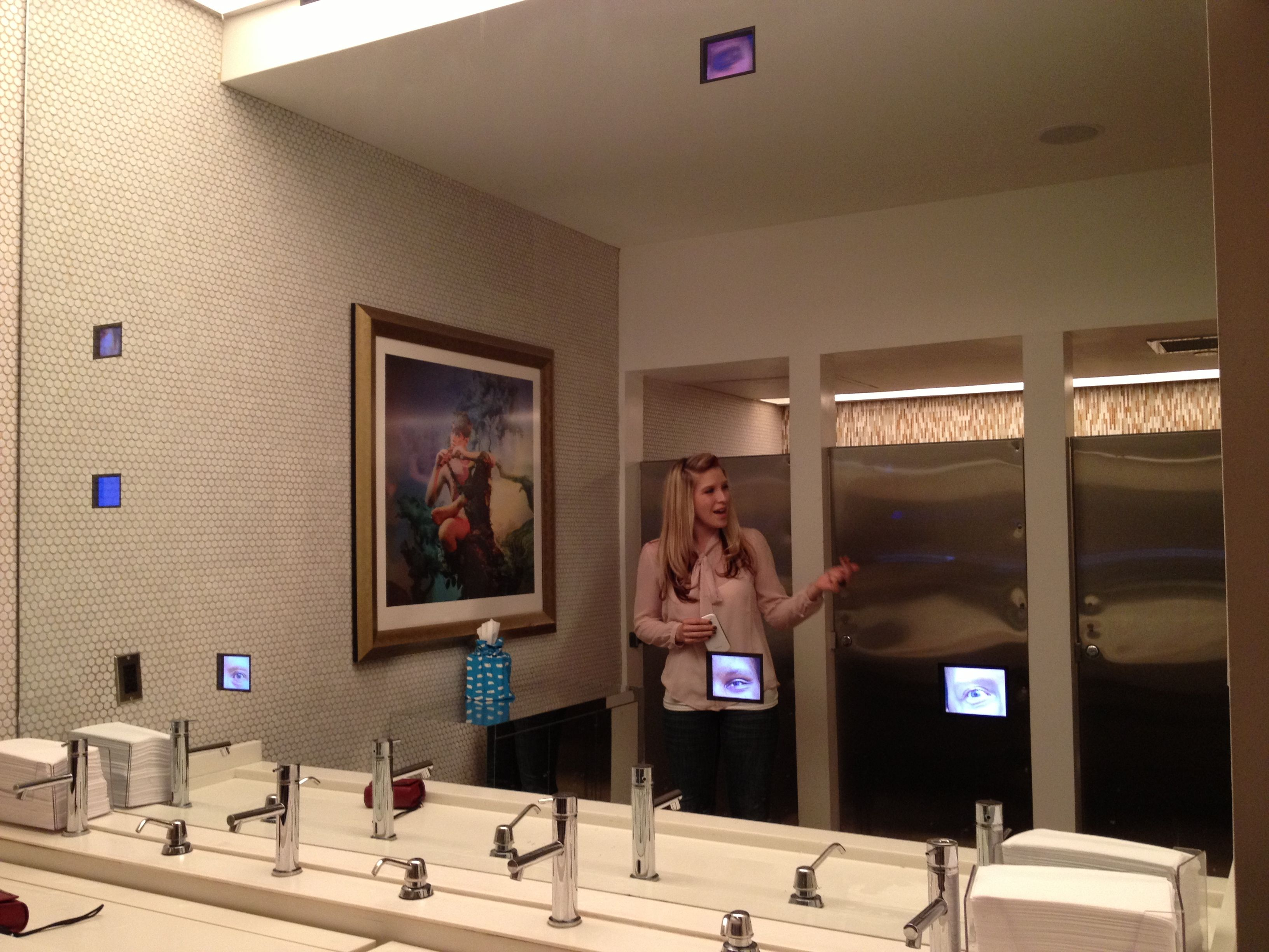 Restroom shared by proof on main and the 21c museum hotel in louisville ky small tv screens for Bathroom mirrors louisville ky