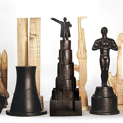 History Chess Set: This chess set is a limited edition of 'eight'; the oversized wooden chess pieces are hand-carved and each piece represents a historic event or icon from the 20th century.