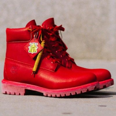 best cheap f0406 e1112 pharrell rocks his own customized bee line x timberland red boot to accept  hollywood star