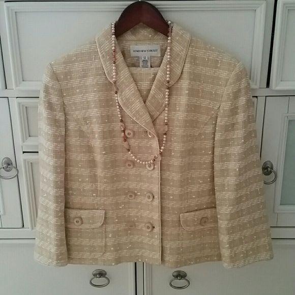 Jones of New York Suit Beautiful tweed look/feel Jones of New York Suit. The jacket comes to mid waist. The color is  a creamy soft  yellow and soft pink w/yellow buttons. Very Hepbornish. Worn a few times in perfect condition. Jones New York Other