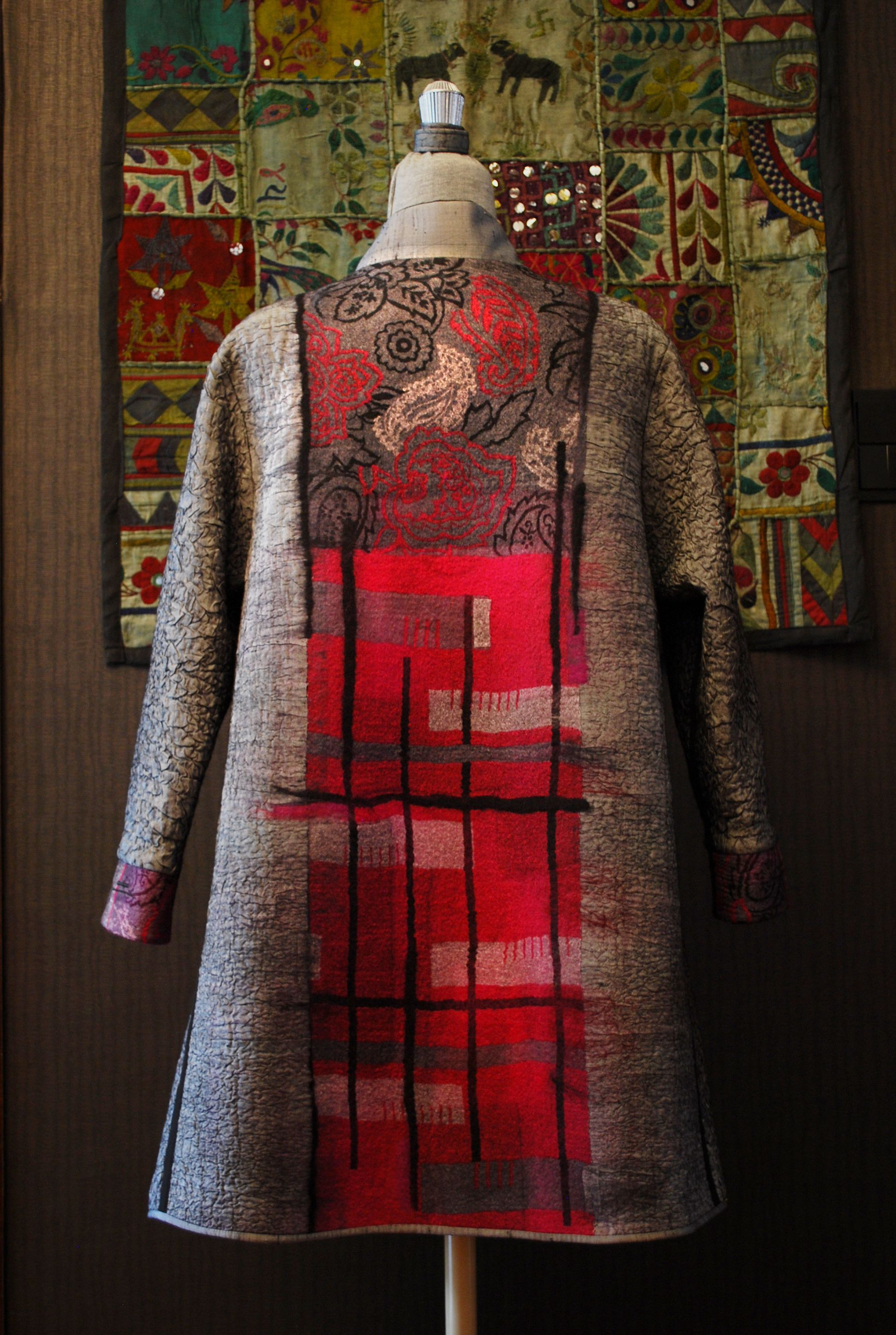 Beautiful geometries and patterning on the back of this coat