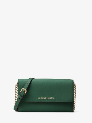 28538b56addc1 Clean lines and a chic demeanor define our darling Jet Set Travel  crossbody. The compact Saffiano leather silhouette unfolds to a functional  array of ...
