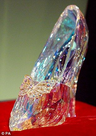 b69a00e0133 The Swarovski glass slippers worn by Lily James in Cinderella (left) were  designed by Sand.