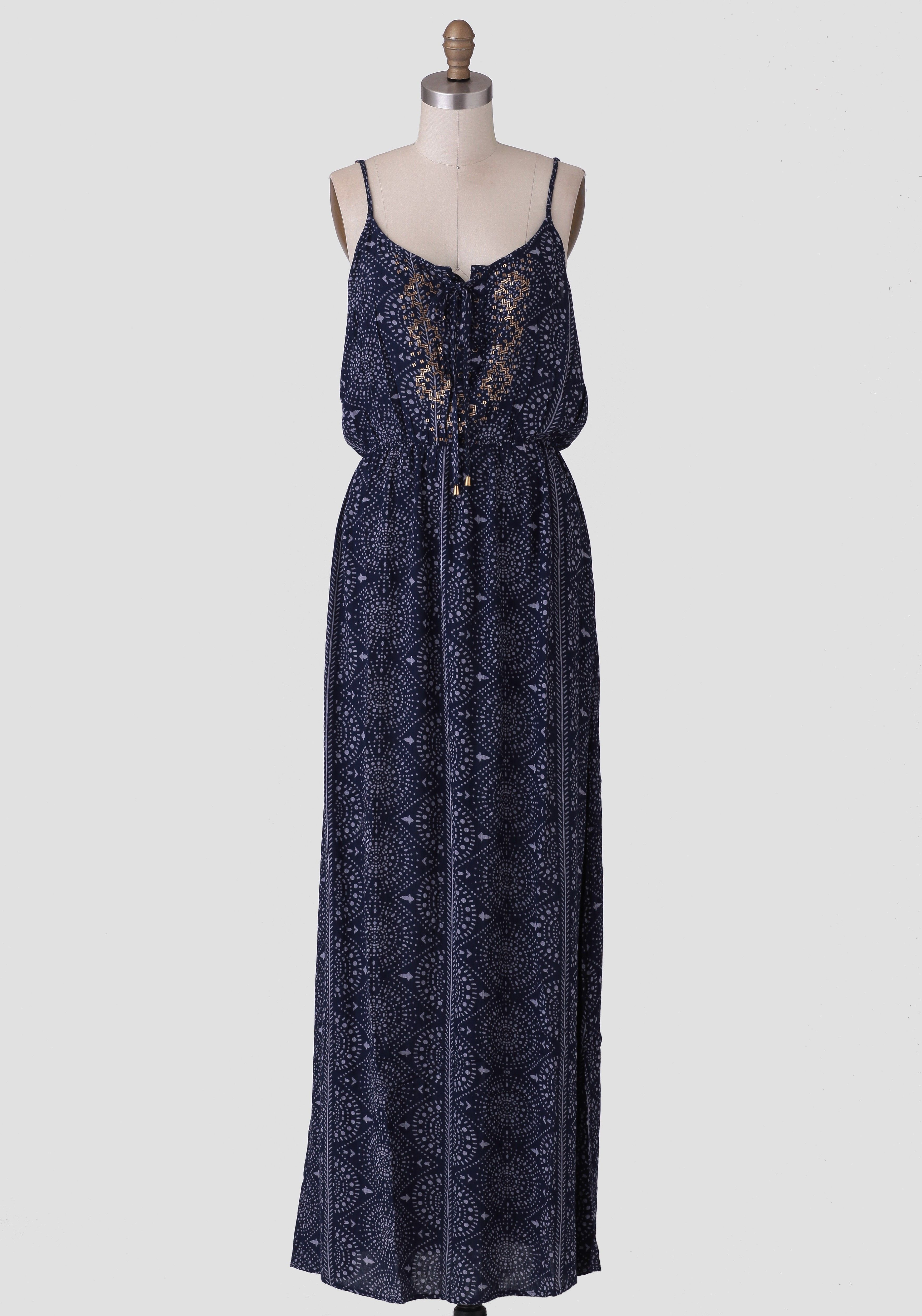 A ruchette musthave this navy blue maxi dress is rendered in a