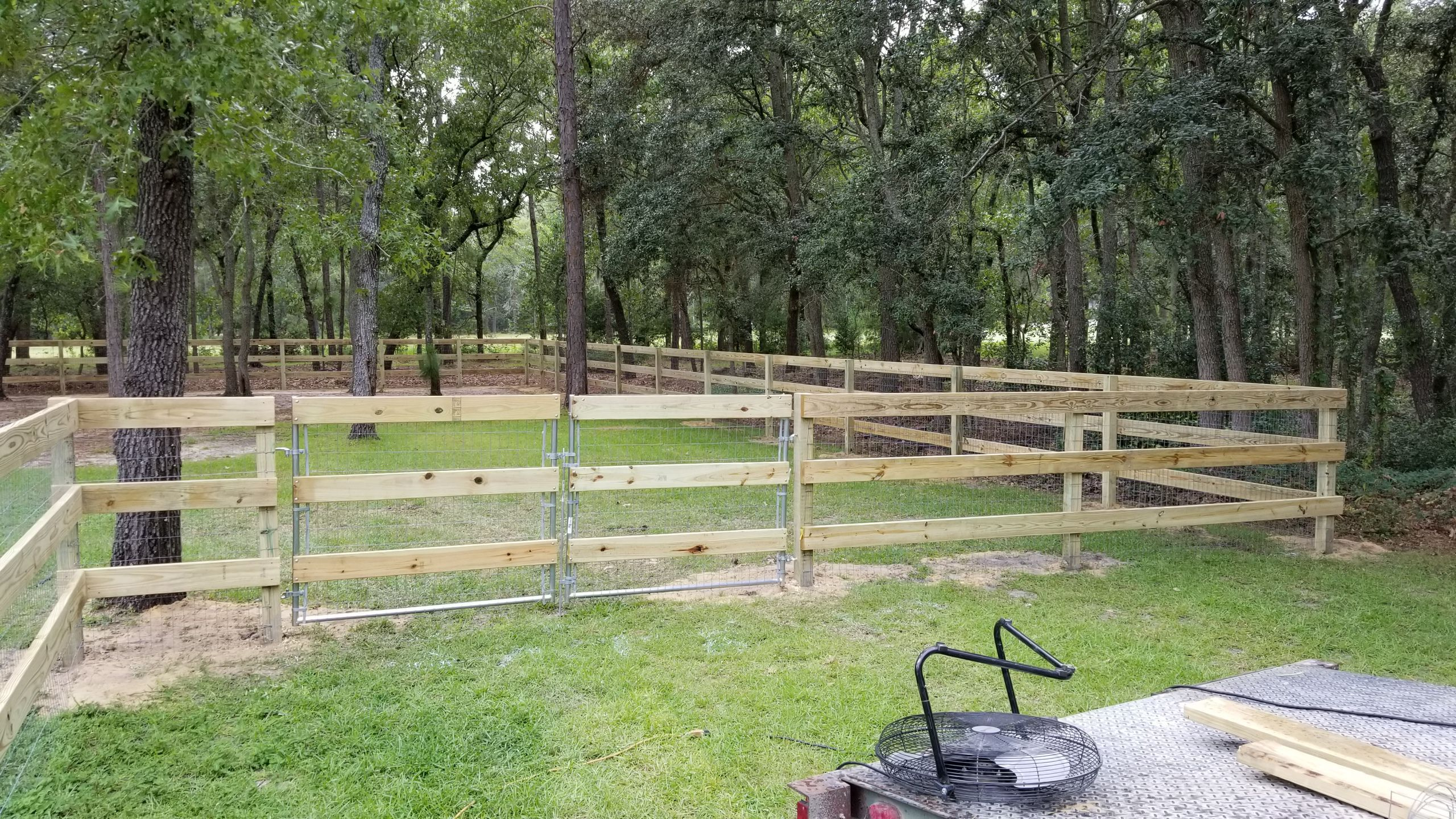 2x6 three rail farm fence with wire mesh. Reinforced steel ...