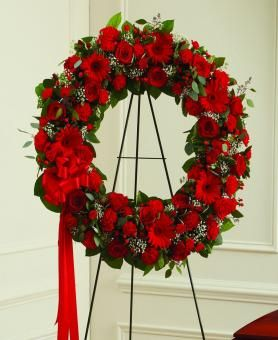 Send a sympathy wreath to a funeral home for same day low cost delivery...