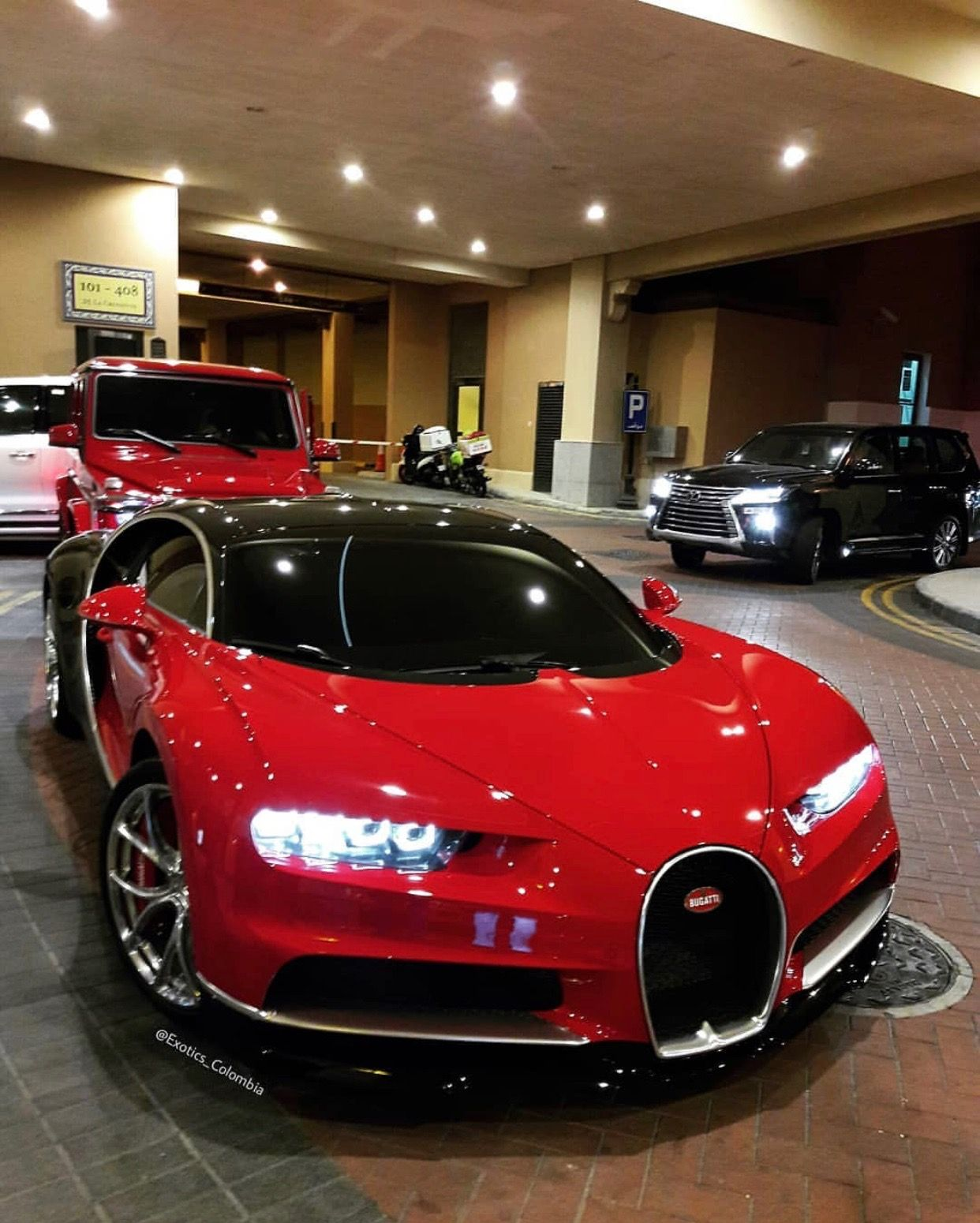 Bugatti Chiron painted in Red & Black w/ chrome accents Photo taken by: @exotics_columbia on ...