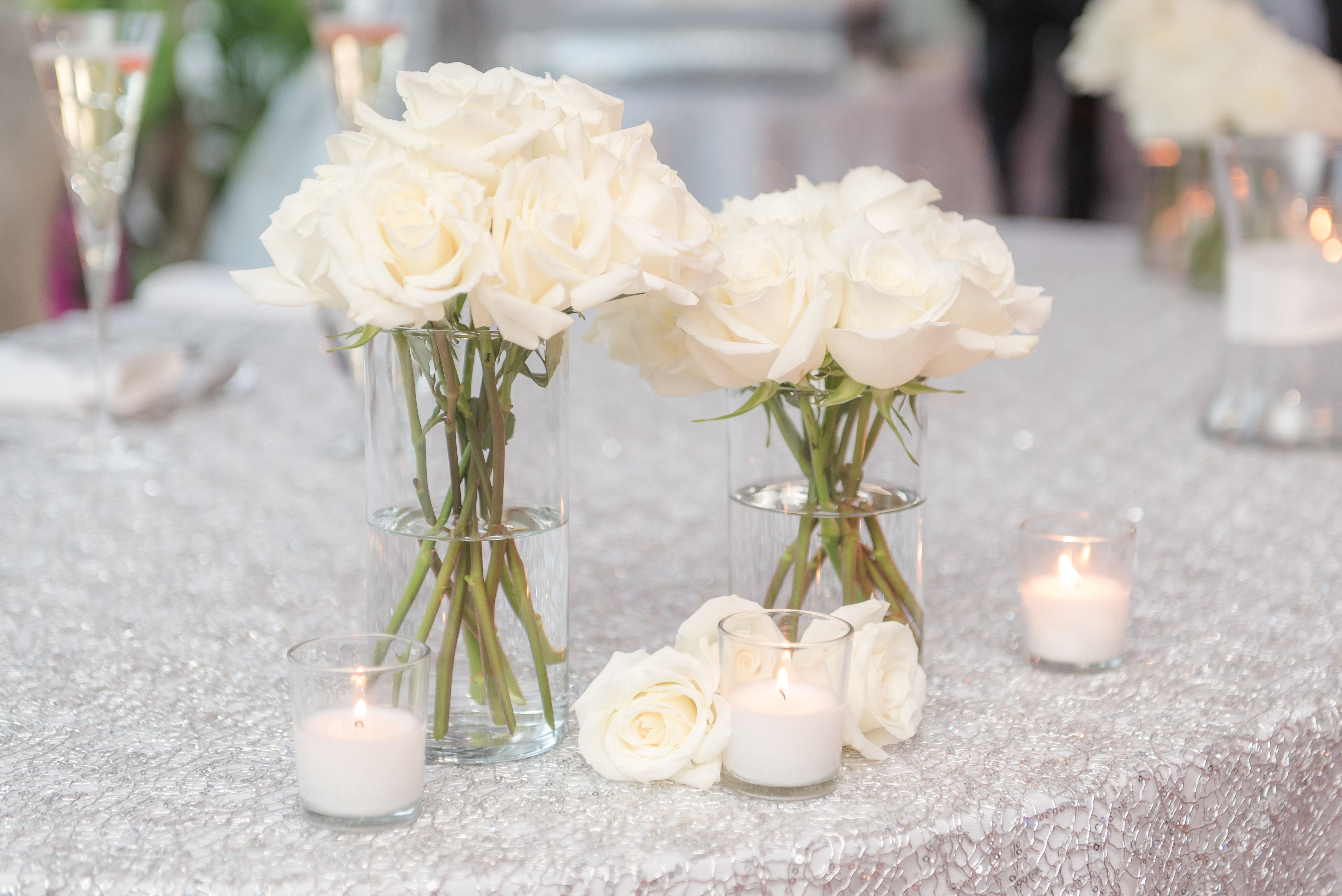 Ivory rose florals and candle centerpieces | Windows on the Water at ...