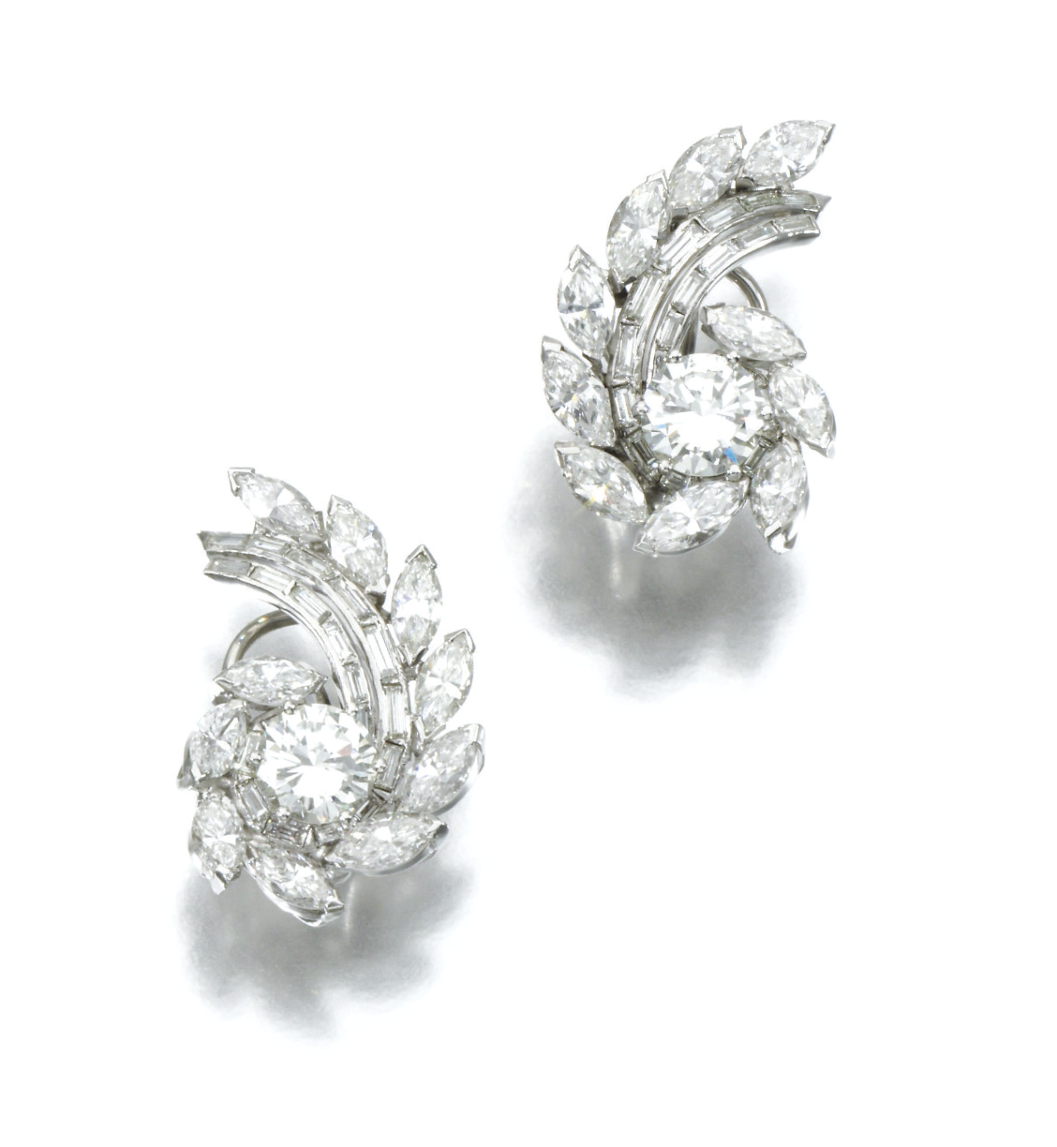 PAIR OF DIAMOND EARRINGS Each of swirl design set with marquise