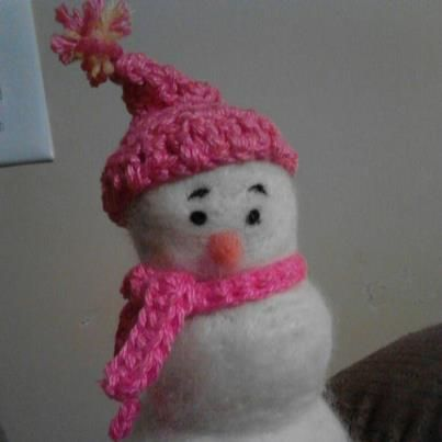 12/17/12 Needle felted snowman. I crocheted his scarf and hat. I wasn't sure how to do the hat so just made a circle big enough to go around his head and then just kept decreasing stitches. made by Jamie Malley