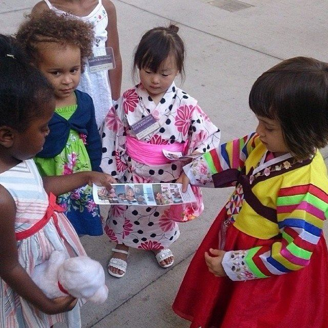 Children from many nationalities sharing gifts on Saturday of the convention