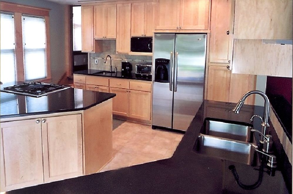Maple Cabinetry natural finish.   Contemporary kitchen ...