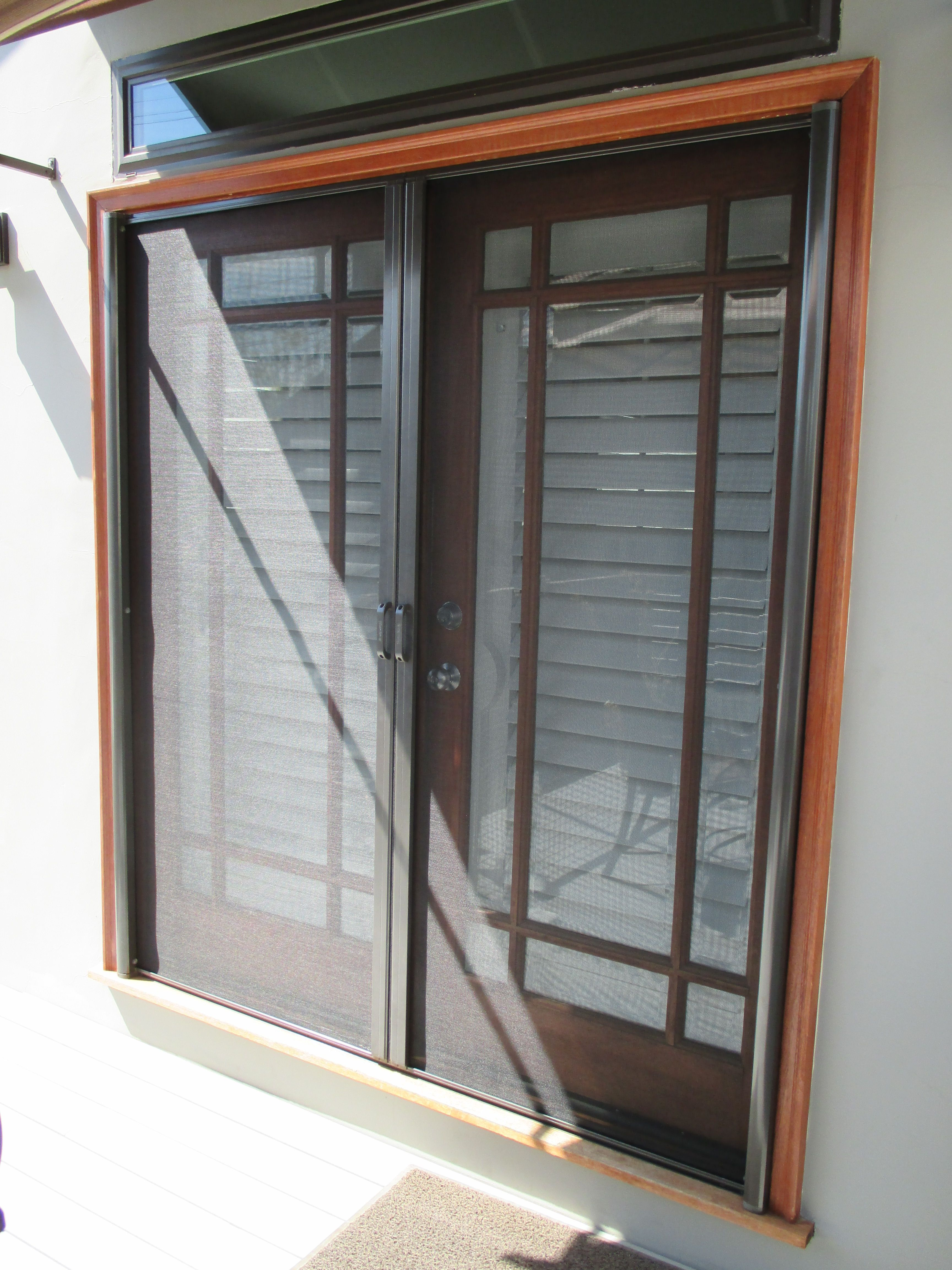 Double Door Retractable Stowaway Screen Installed On These Beautiful French Doors In Orange County California