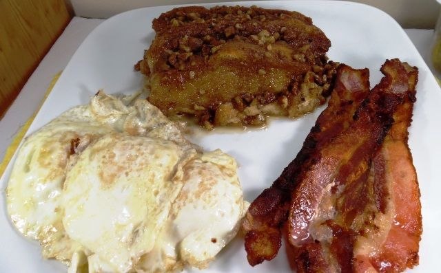French toast casserole with bacon and over easy eggs