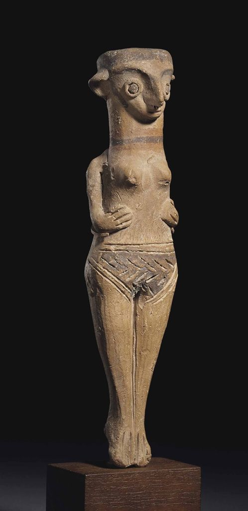 A CYPRIOT TERRACOTTA FEMALE FIGURE LATE BRONZE AGE, BASE RING WARE, CIRCA 1450-1200 B.C.