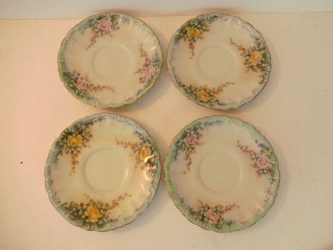Ornate Vintage Decorative Yellow and Pink Floral Saucers www.thesecondhandplanet.com