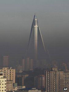The Ryugyong Hotel stand above the smog dominating the Pyongyang skyline in 2011 - never finished and empty for 26 years, but soon to open for business
