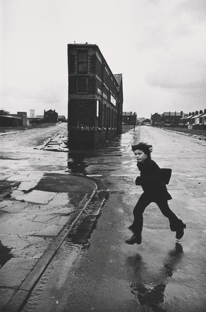 Thats me in the picture stasia franek vaults a puddle for don mccullin liverpool early 1970s liverpool englandblack white