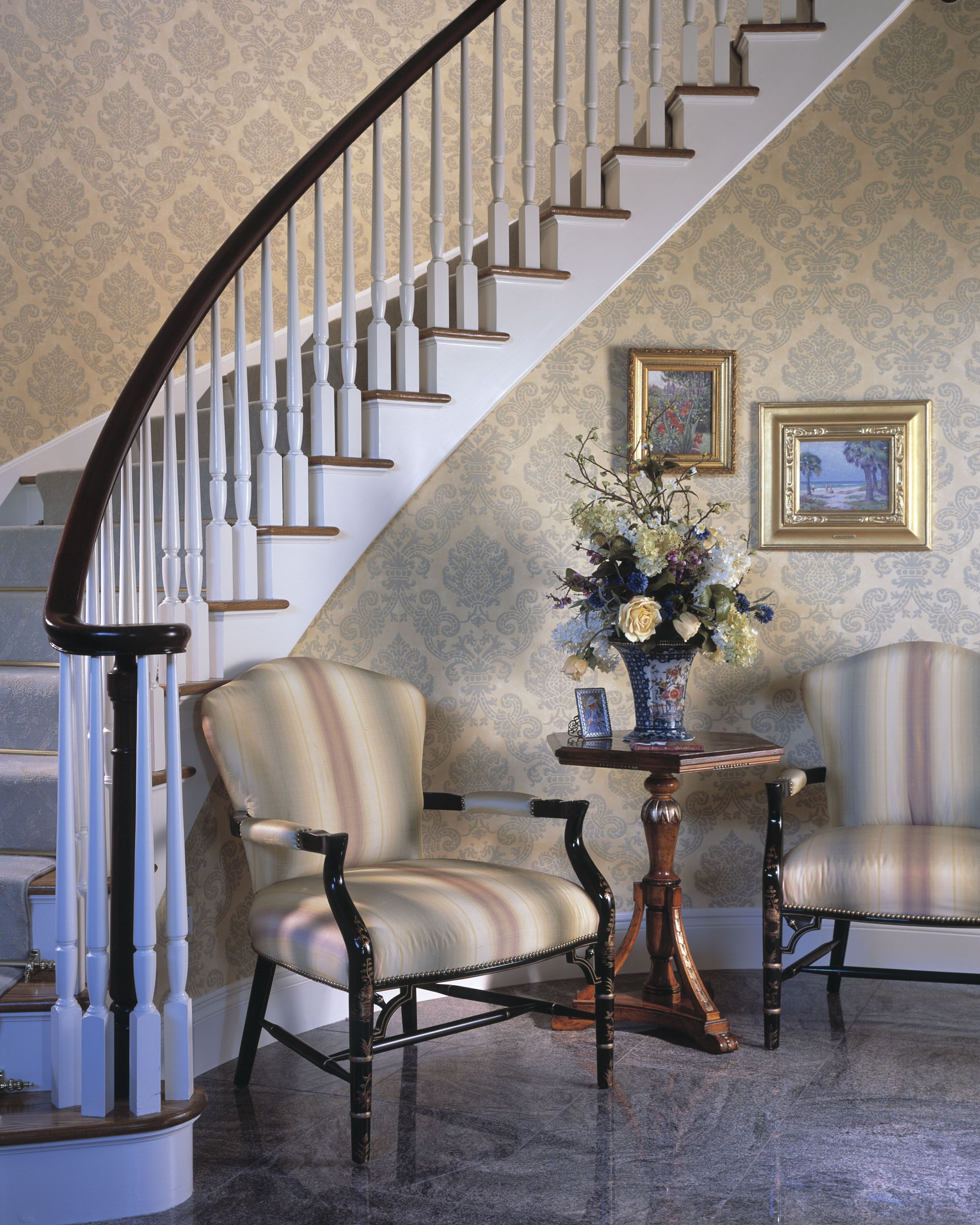 Georgian house style foyer with pale damask print wallpaper.
