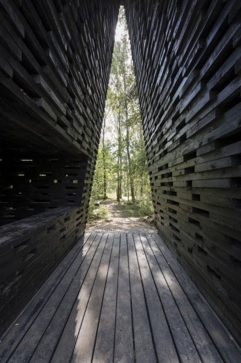 The ARC, by  Boris Bernaskoni Architects in Nikola-Lenivets, Kaluga Oblast, Russia. The ARC is situated on the edge of a forest and its 13.2 meter high blackened timber structure, acts both as a kind of triumphal arch and portal to the forest.