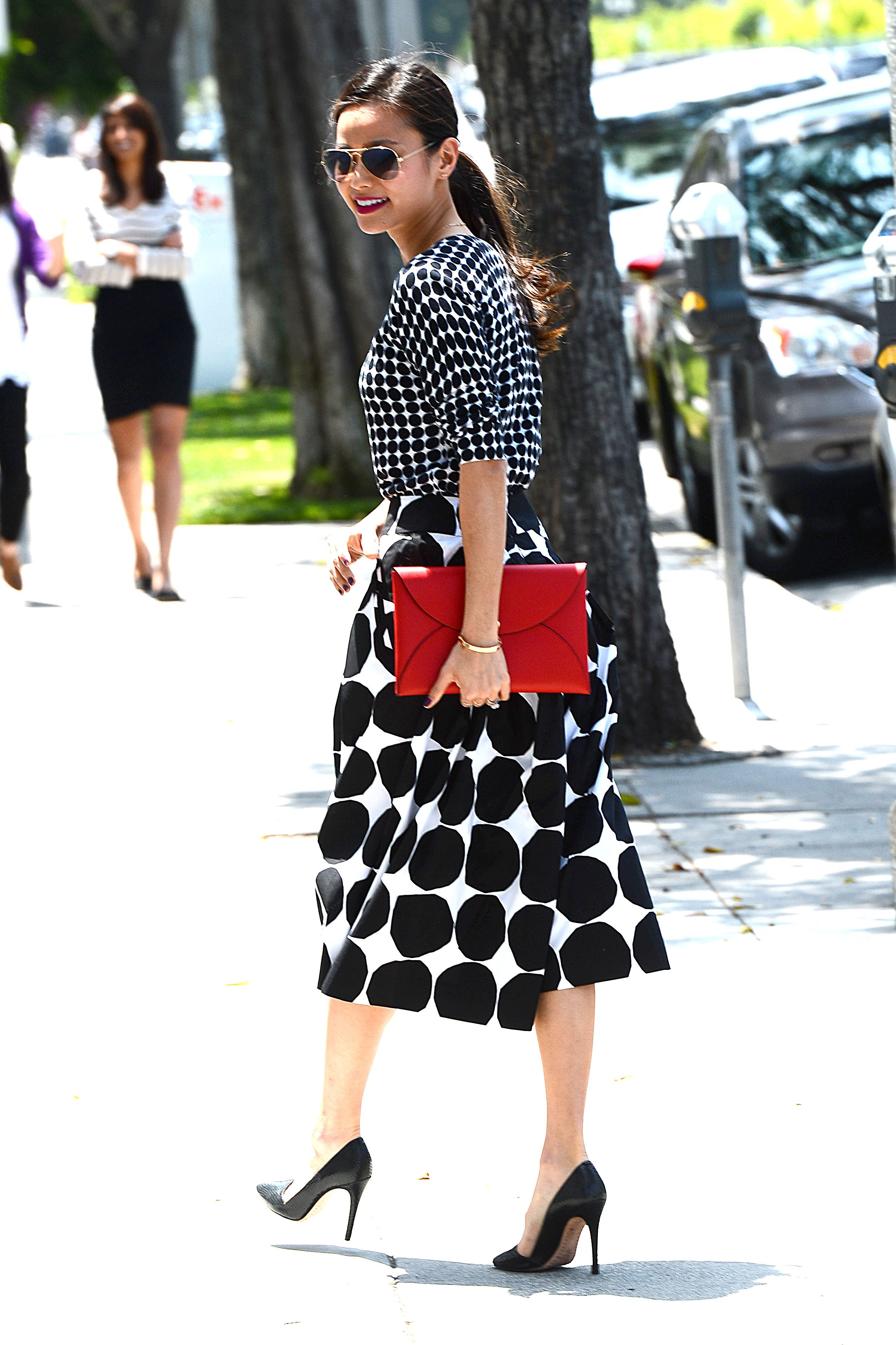 Jamie Chung spotted in Banana Republic x Marimekko midi skirt and sweater.